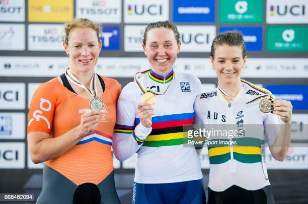 Katie Archibald of Great Britain celebrates winning the Women's Omnium Points Race 4/4 with Kirsten Wild of Netherlands and Amy Cure of Australia...