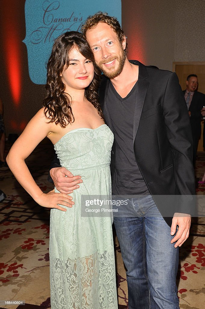 Katie Boland and Kris Holden Reid arrive at the Hello! Canada gala celebrating Canada's 50 most beautifulat Shangri-La Hotel on May 9, 2013 in Toronto, Canada.