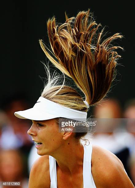 Katie Boulter of Great Britain during her Girls' Singles first round match against Priscilla Hon of Australia on day seven of the Wimbledon Lawn...