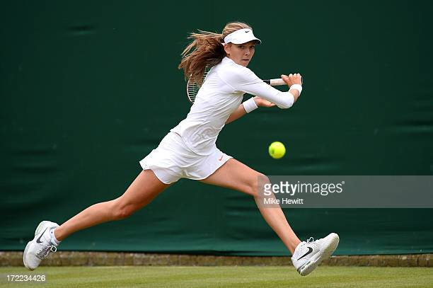 Katie Boulter of Great Britain plays a backhand during the Girls' Singles second round match against Elise Mertens of Belgium on day eight of the...