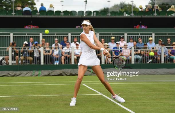 Katie Boulter of Great Britain plays a backhand during the Ladies Singles first round match against Christina McHale of The United States on day two...
