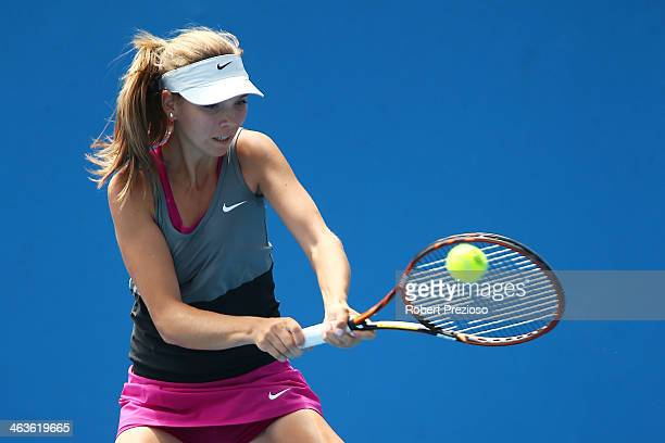 Katie Boulter of Great Britain plays a backhand in her first round junior girls' match against Dhruthi Tatachar Venugopal of India during the 2014...