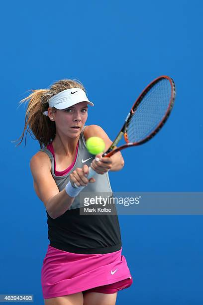 Katie Boulter of Great Britain plays a backhand in her second round junior girls' match against Natalie Vikhlyantseva of Russia during the 2014...
