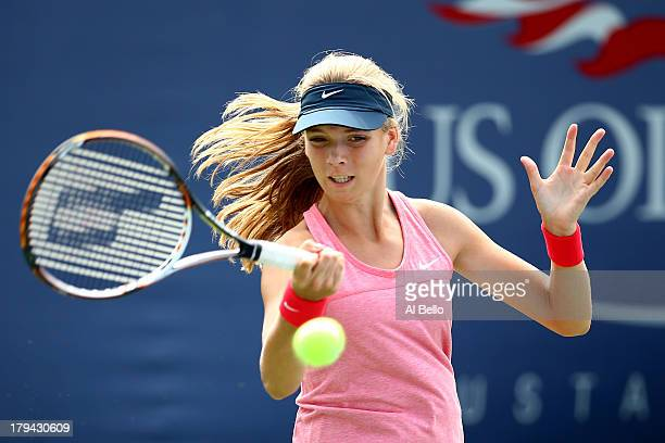 Katie Boulter of Great Britain plays a forehand during her girls' singles first round match against Usue Maitane Arconada of the United States of...
