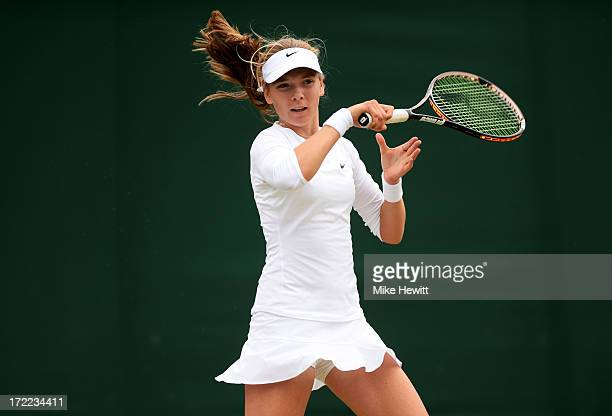 Katie Boulter of Great Britain plays a forehand during the Girls' Singles second round match against Elise Mertens of Belgium on day eight of the...