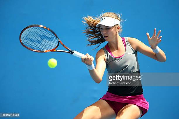Katie Boulter of Great Britain plays a forehand in her first round junior girls' match against Dhruthi Tatachar Venugopal of India during the 2014...