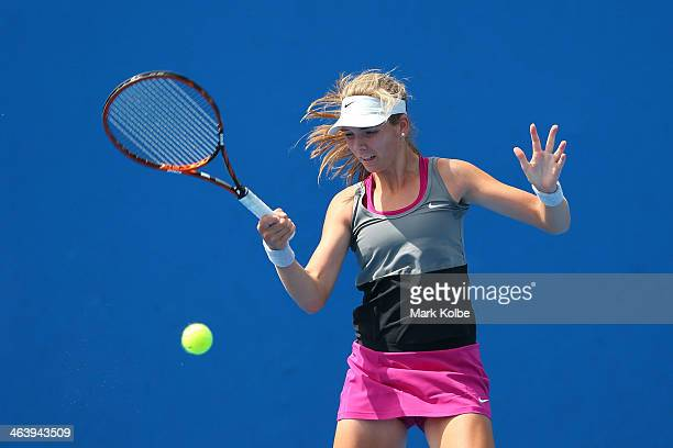 Katie Boulter of Great Britain plays a forehand in her second round junior girls' match against Natalie Vikhlyantseva of Russia during the 2014...