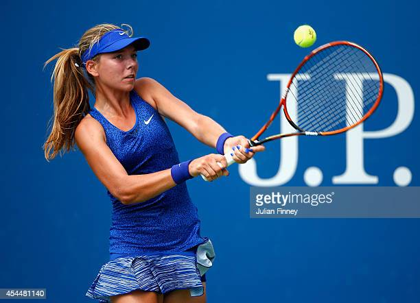 Katie Boulter of Great Britain returns a shot against Katerina Stewart of the United States during their junior girls' singles first round match on...