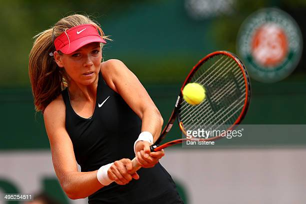 Katie Boulter of Great Britain returns a shot during her girls' singles match against Raveena Kingsley of the United States on day nine of the French...