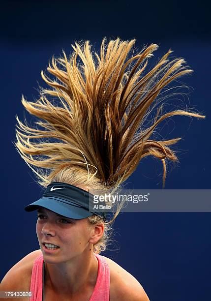 Katie Boulter of Great Britain serves during her girls' singles first round match against Usue Maitane Arconada of the United States of America on...