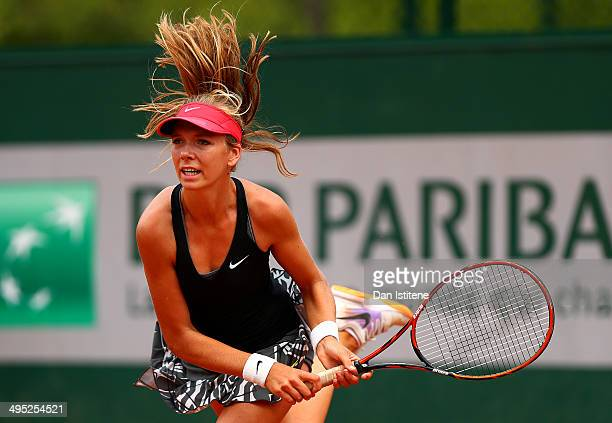 Katie Boulter of Great Britain serves during her girls' singles match against Raveena Kingsley of the United States on day nine of the French Open at...