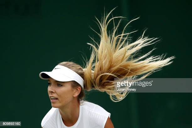 Katie Boulter of Great Britain serves during the Ladies Doubles first round match with Katie Swan of Great Britain against Timea Babos of Hungary and...