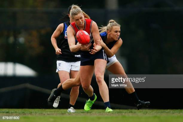 Katie Brennan of Darebin Falcons gets tackled by Bailey Hunt of Melbourne Uni during the round one VFL Women's match between the Darebin Falcons and...