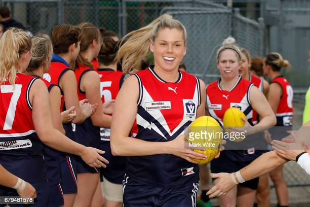 Katie Brennan of Darebin Falcons runs out onto the field during the round one VFL Women's match between the Darebin Falcons and Melbourne Uni at Bill...
