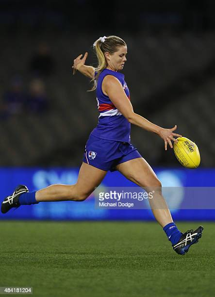 Katie Brennan of the Bulldogs kicks the ball for a goal during a Women's AFL exhibition match between Western Bulldogs and Melbourne at Etihad...