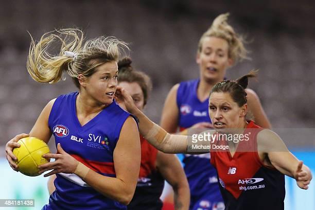 Katie Brennan of the Bulldogs looks upfield during a Women's AFL exhibition match between Western Bulldogs and Melbourne at Etihad Stadium on August...