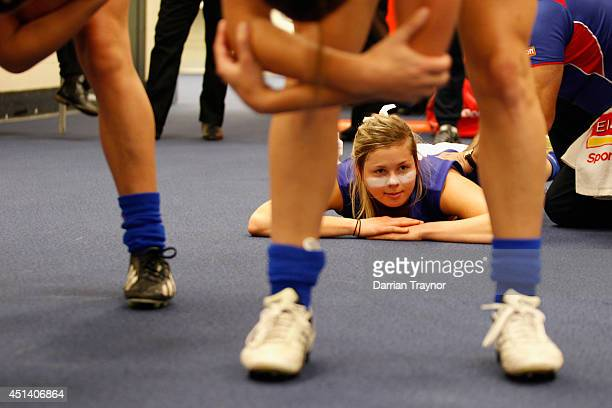 Katie Brennan of the Western Bulldogs Womens team gets a rub down before the women's exhibition AFL match between the Western Bulldogs and the...