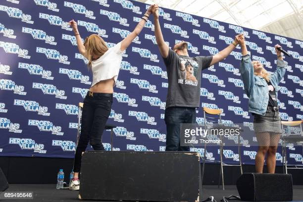 Katie Cassidy Josh Segarra and Emily Bett Rickards take part in the Arrow Panel on day two of Heroes and Villians Convention at Olympia London on May...