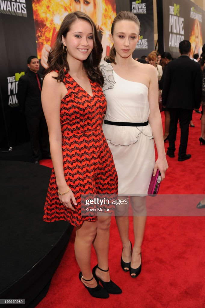 Katie Chang and <a gi-track='captionPersonalityLinkClicked' href=/galleries/search?phrase=Taissa+Farmiga&family=editorial&specificpeople=7447946 ng-click='$event.stopPropagation()'>Taissa Farmiga</a> arrives at the 2013 MTV Movie Awards at Sony Pictures Studios on April 14, 2013 in Culver City, California.