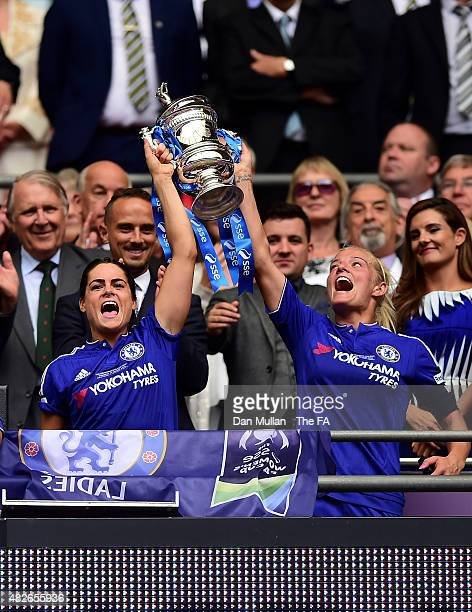 Katie Chapman and Claire Rafferty of Chelsea lift the trophy after victory during the Women's FA Cup Final between Chelsea Ladies FC and Notts County...