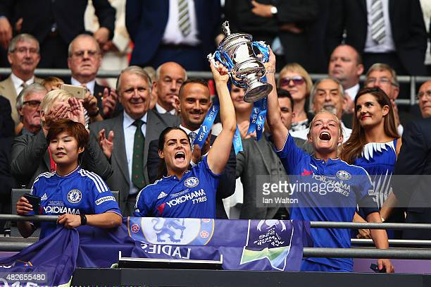 Katie Chapman and Claire Raffery of Chelsea Ladies FC celebrate with the trophy after winning the Women's FA Cup Final match between Chelsea Ladies...