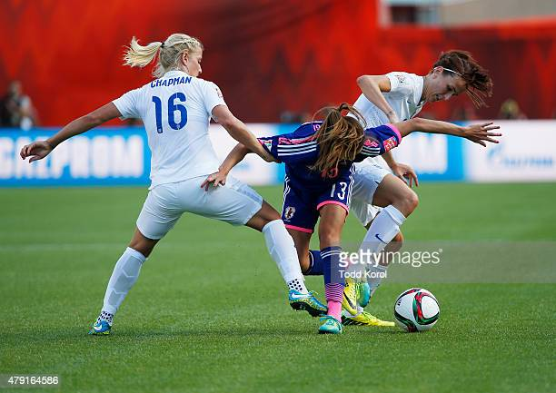 Katie Chapman and Jill Scott of England hold back Rumi Utsugi of Japan from getting the ball during the FIFA Women's World Cup Canada Semi Final...