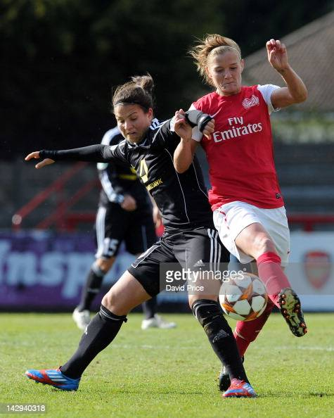 Katie Chapman of Arsenal Ladies FC holds off Dzenifer Marozsan of Frankfurt during the Women's Champions League Semi Final match between Arsenal...