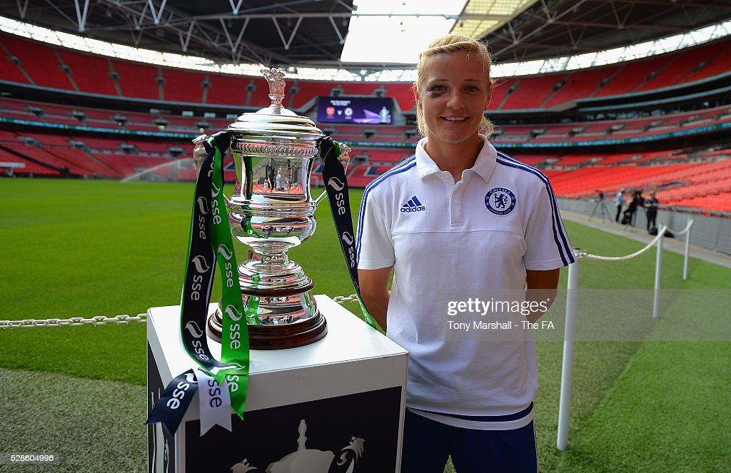 Katie Chapman of Chelsea FC Ladies poses with the SSE Women's FA Cup during the SSE Women's FA Cup Final - Wembley Media Day at Wembley Stadium on May 6, 2016 in London, England.