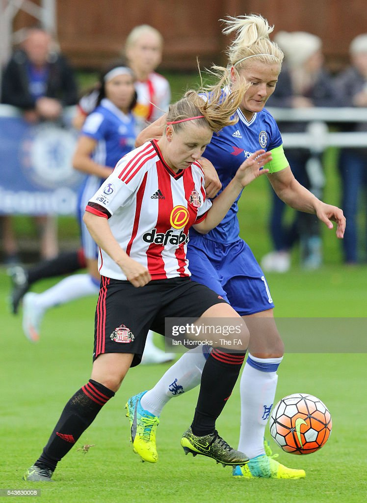Katie Chapman of Chelsea (R) tussles with Beth Mead of Sunderland during the WSL 1 League match between Sunderland Ladies and Chelsea Ladies FC at the Hetton Center on June 29, 2016 in Hetton, England.