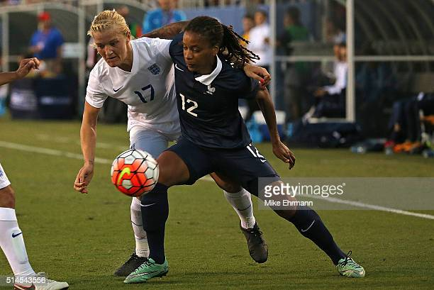 Katie Chapman of England and Elodie Thomis of France fight for the ball during a match against in the 2016 SheBelieves Cup at FAU Stadium on March 9...