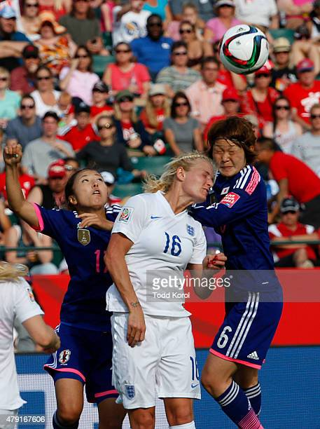 Katie Chapman of England and Yuki Ogimi and Mizuho Sakaguchi of Japan go up for a header during the FIFA Women's World Cup Canada Semi Final match...