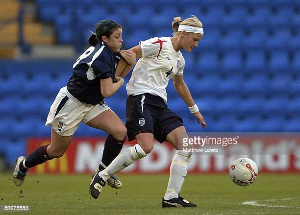 Katie Chapman of England holds off Megan Sneddon of Scotland during the Womens International Friendly match between England and Scotland at Prenton...