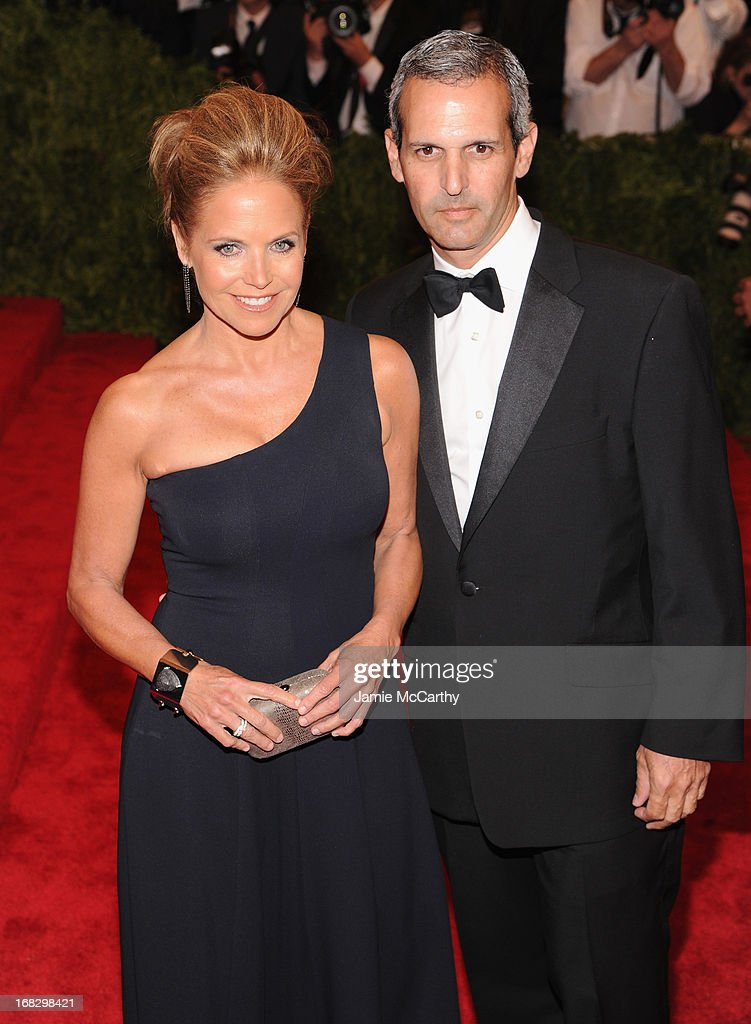 Katie Couric and John Molner attend the Costume Institute Gala for the 'PUNK: Chaos to Couture' exhibition at the Metropolitan Museum of Art on May 6, 2013 in New York City.