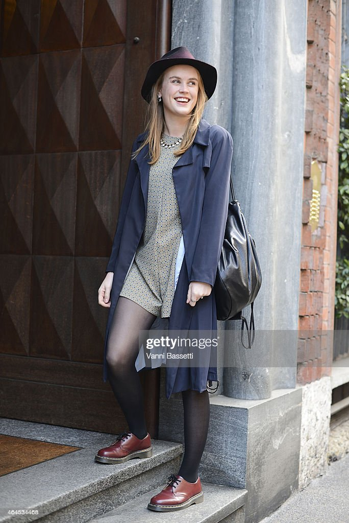 Katie Delany poses wearing Zara coat and dress vintage hat and Dr Martens shoes on February 26 2015 in Milan Italy