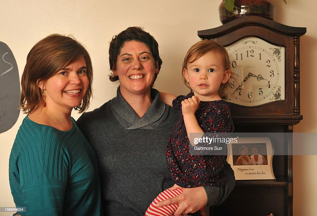 Katie Dongarra, left, and Sharon Dongarra pose for a photo with their two-year-old daughter, Lucy, on Tuesday, December 31, 2012, in Towson, Maryland. A couple for 17 years, Katie and Sharon will legally wed on New Year's Day.