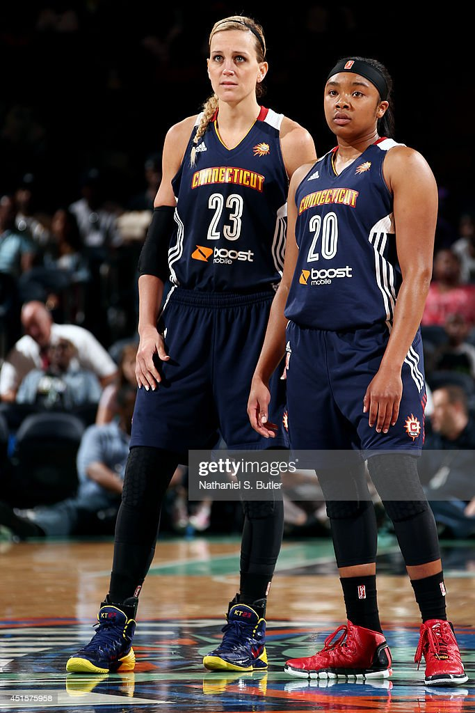 Katie Douglas and Alex Bentley of the Connecticut Sun stand on the court during a game against the New York Liberty at Madison Square Garden in New...