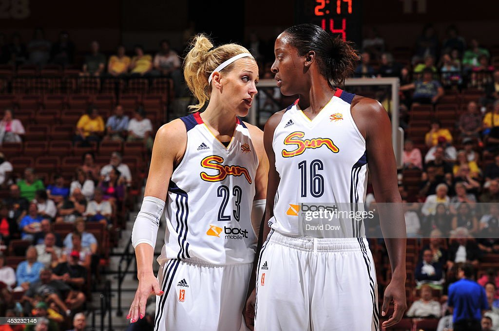 Katie Douglas and Ebony Hoffman of the Connecticut Sun strategize on the court against the Chicago Sky on August 5 2014 at the Mohegan Sun Arena in...