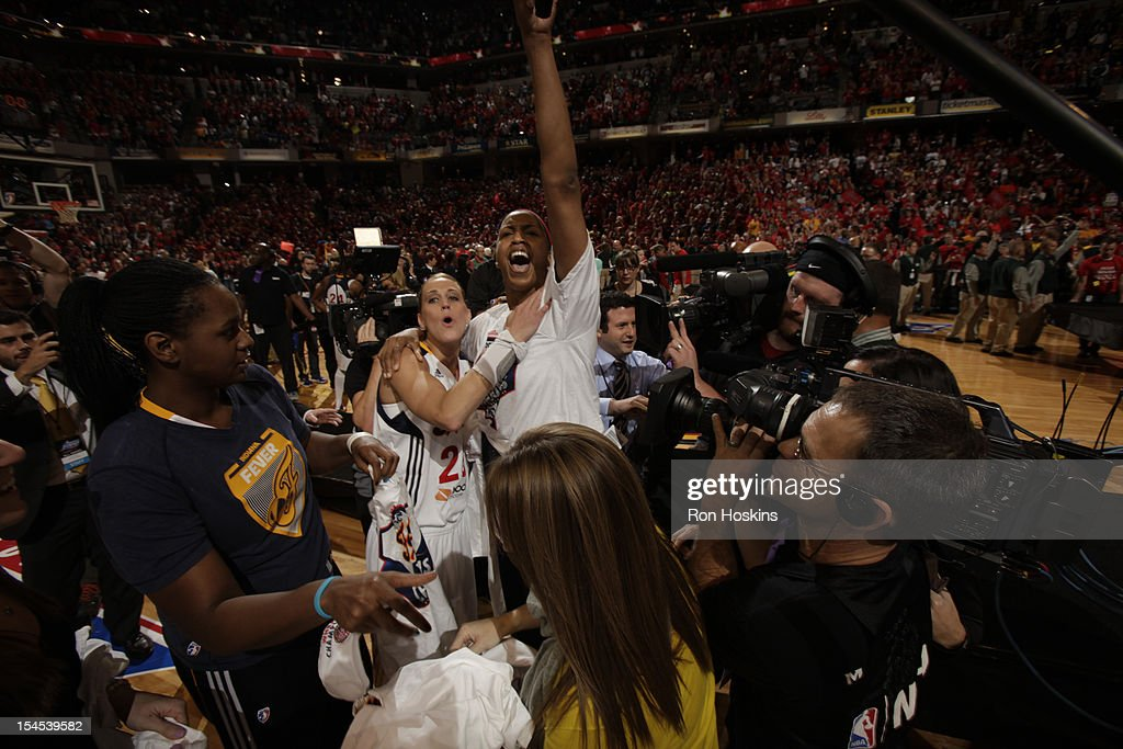 Katie Douglas #23 and Tammy Sutton-Brown of the Indiana Fever celebrates against the Minnesota Lynx during Game four of the 2012 WNBA Finals on October 21, 2012 at Bankers Life Fieldhouse in Indianapolis, Indiana.
