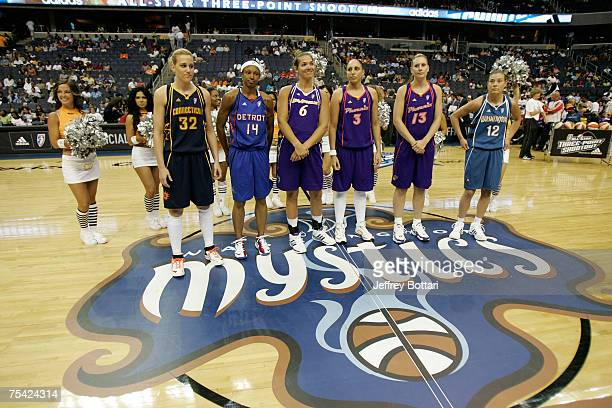 Katie Douglas Deanna Nolan Sidney Spencer of the Los Angeles Sparks Diana Taurasi and Penny Taylor of the Phoenix Mercury Laurie Koehn of the...