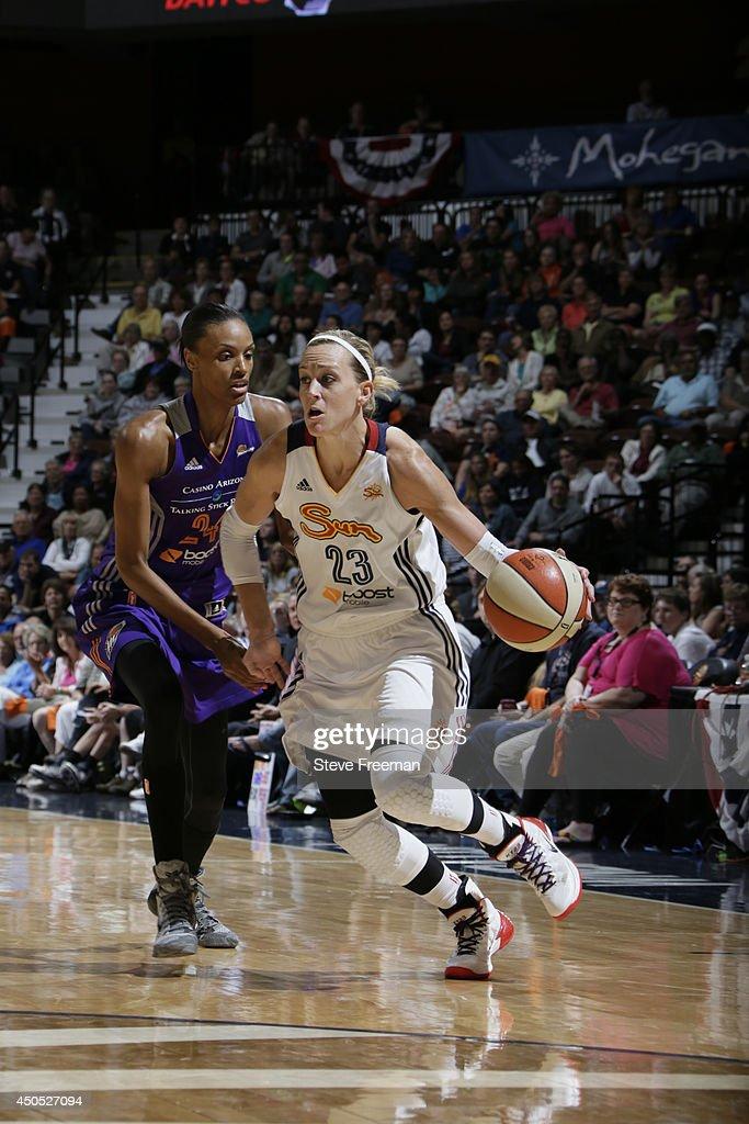 Katie Douglas of the Connecticut Sun drives against DeWanna Bonner the Phoenix Mercury on June 12 2014 at Mohegan Sun Arena in Uncasville Connecticut...