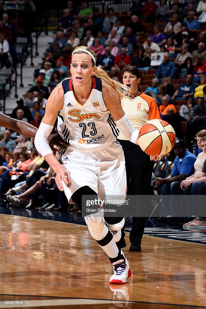 Katie Douglas of the Connecticut Sun drives against the New York Liberty on May 18 2014 at the Mohegan Sun in Uncasville Connecticut NOTE TO USER...