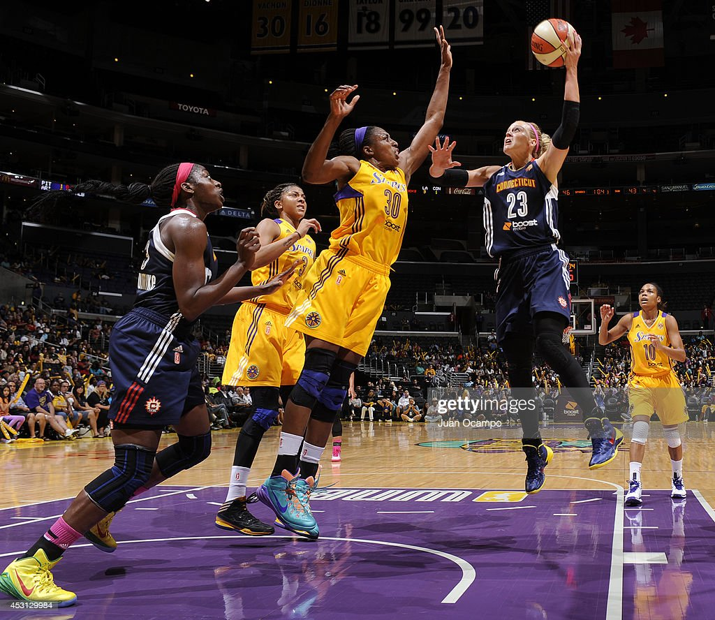 Katie Douglas of the Connecticut Sun drives to the basket against Nneka Ogwumike of the Los Angeles Sparks at STAPLES Center on August 3 2014 in Los...