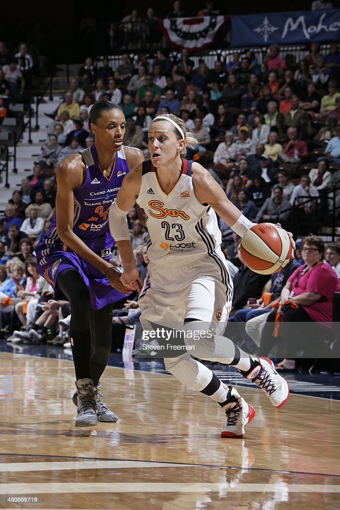 Katie Douglas of the Connecticut Sun drives to the basket against the Phoenix Mercury on June 12 2014 at Mohegan Sun Arena in Uncasville Connecticut...