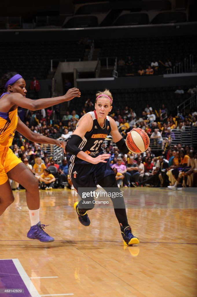 Katie Douglas of the Connecticut Sun drives to the basket against the Los Angeles Sparks at STAPLES Center on August 3 2014 in Los Angeles California...