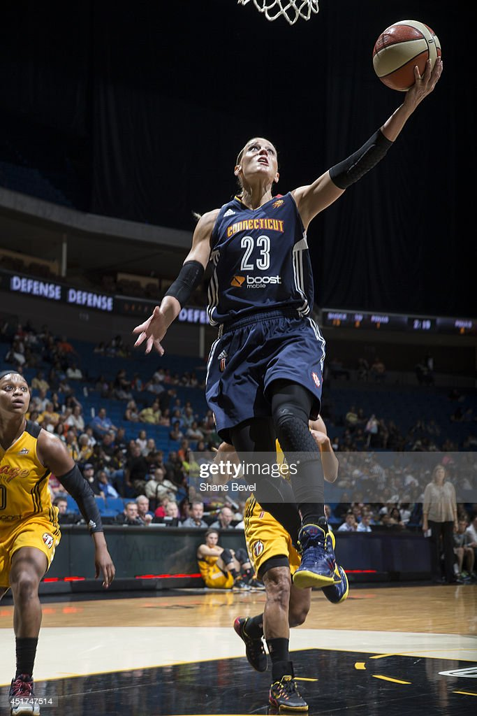 Katie Douglas of the Connecticut Sun goes up for a shot against the Tulsa Shock during the WNBA game on July 5 2014 at the BOK Center in Tulsa...