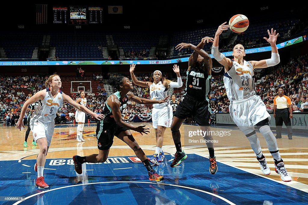 Katie Douglas of the Connecticut Sun grabs a rebound against the New York Liberty on June 15 2014 at the Mohegan Sun in Uncasville Connecticut NOTE...