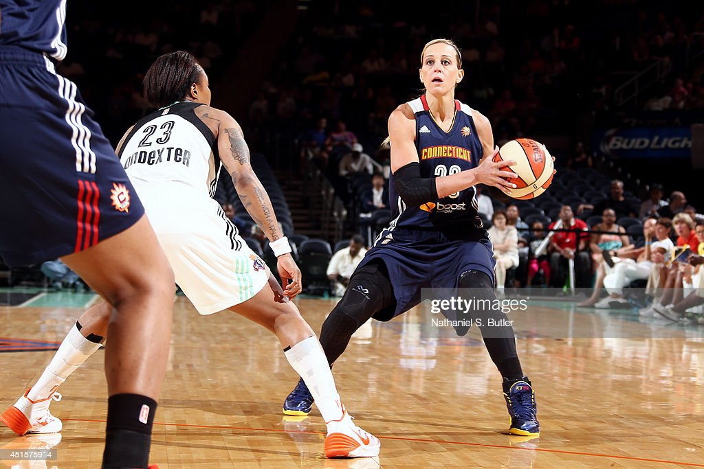 Katie Douglas of the Connecticut Sun handles the ball against the New York Liberty at Madison Square Garden in New York City on June 29 2014 NOTE TO...