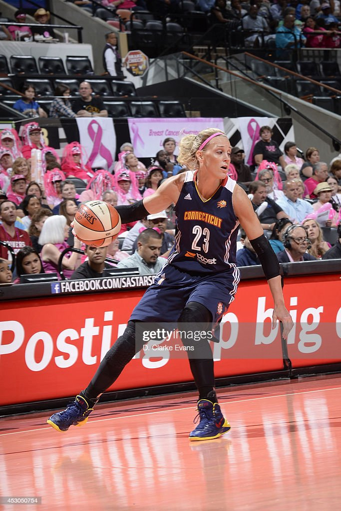 Katie Douglas of the Connecticut Sun handles the ball against the San Antonio Stars at the ATT Center on August 1 2014 in San Antonio Texas NOTE TO...