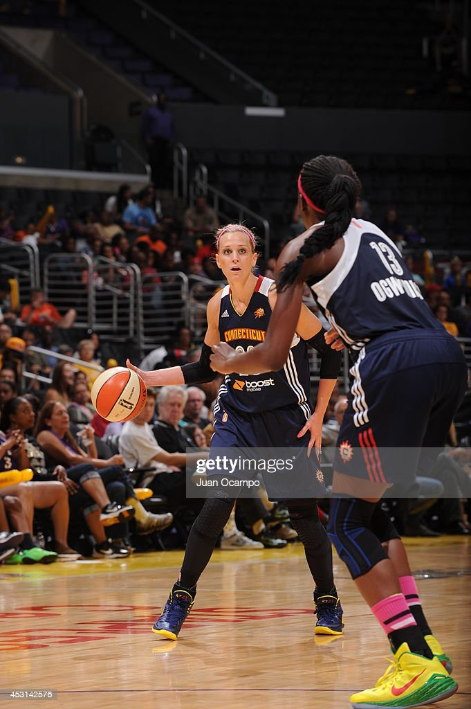 Katie Douglas of the Connecticut Sun passes the ball to teammate Chiney Ogwumike during the game against the Los Angeles Sparks at STAPLES Center on...