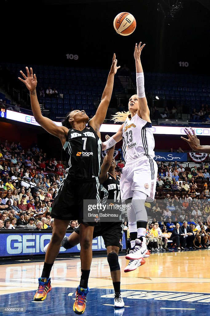 Katie Douglas of the Connecticut Sun shoots against Avery Warley of the New York Liberty on June 15 2014 at the Mohegan Sun in Uncasville Connecticut...